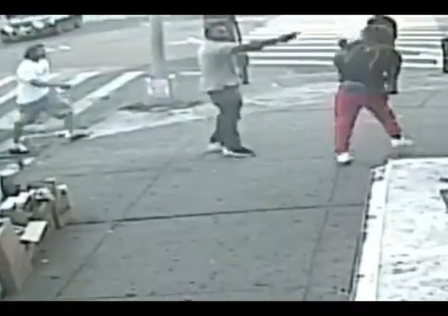 A screenshot from a video of a gunman opening fire on 20-year-old Deondraye Moore in Brooklyn's Brownsville neighborhood, New York City, US, 02.07.2020.