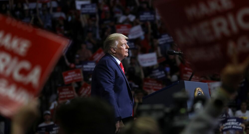 U.S. President Donald Trump stands at the podium listening to his supporters cheer as he addresses his first re-election campaign rally in several months in the midst of the coronavirus disease (COVID-19) outbreak, at the BOK Center in Tulsa, Oklahoma, U.S., June 20, 2020.