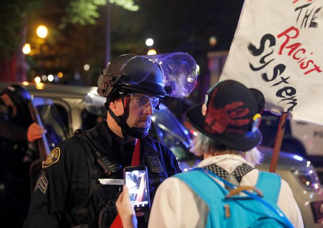 A police officer confronts a protester rallying against the death in Minneapolis police custody of George Floyd, in Portland, Oregon, U.S. June 13, 2020. Picture taken June 13.