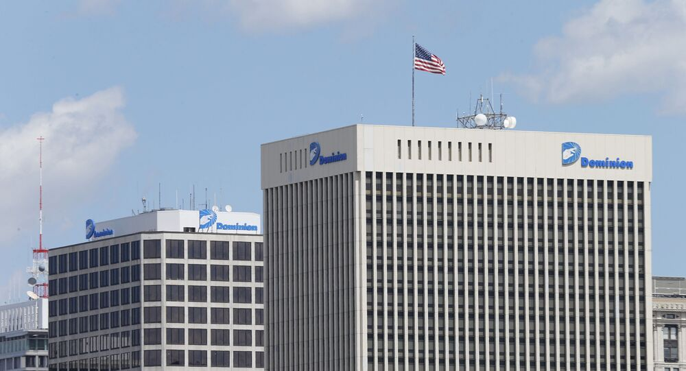 This April 28, 2015, file photo shows two Dominion Energy buildings in downtown Richmond, Va. The developers of the Atlantic Coast Pipeline announced Sunday, July 5, 2020, that they are canceling the multi-state natural gas project, citing delays and increasing cost uncertainty.