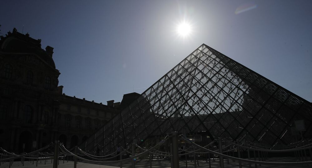 In this Tuesday, 23 June 2020 file photo, the pyramid of the Louvre museum is pictured before a visit ahead of its 6 July reopening in Paris. The European Union announced Tuesday, 30 June 2020 that it will reopen its borders to travellers from 14 countries, but most Americans have been refused entry for at least another two weeks due to soaring coronavirus infections in the US.