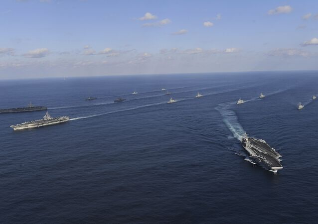 USS Nimitz, left top, USS Ronald Reagan, left center