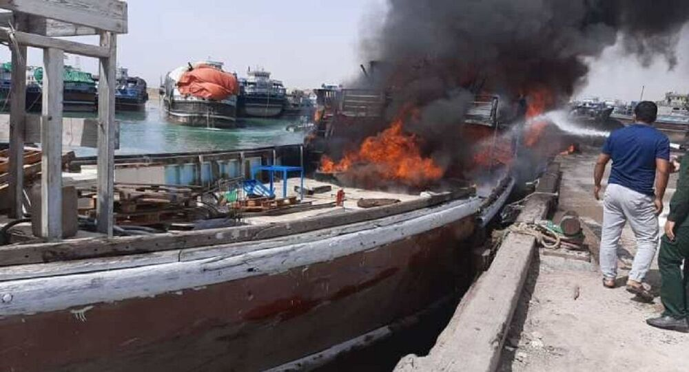 Container ship catches fire in southern Iranian port