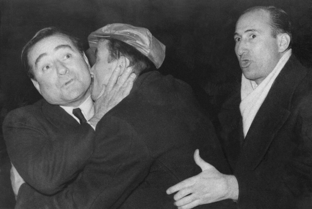 An unidentified supporter hugs and kisses Turkish Prime Minister Adnan Menderes, left, following his arrival by air in Istanbul, Turkey, 26 February 1959 from London. The man to the right is also an unidentified supporter. Menderes, who nine days before had survived an airplane crash was given a tumultuous welcome by more than 10,000 shouting Turks when his chartered British plane landed at Yeshilkoy Airport. Cheering crowds broke through barriers of police and soldiers and nearly crushed the prime minister in their enthusiasm.