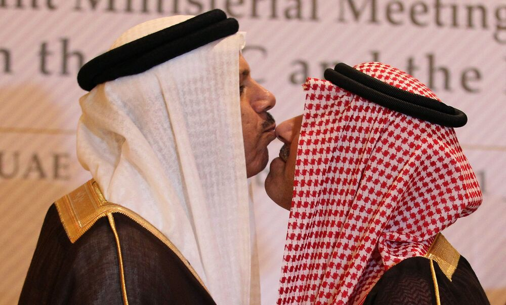 Saudi Arabia's deputy foreign minister, Prince Abdul Aziz bin Abdullah (R), and the Gulf Cooperation Council (GCC) secretary general, Abdul Latif al-Zayyani, exchange a traditional kiss on the sidelines of a meeting to discuss dialogue between the six-nation GCC and Russia in Abu Dhabi on 1 November 2011.