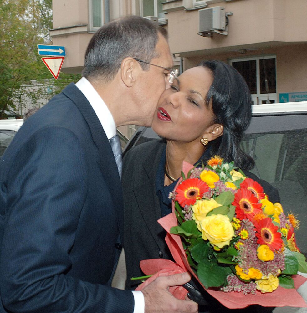 Russian Foreign Minister Sergei Lavrov and US Secretary of State Condoleezza Rice greet each other with a kiss.