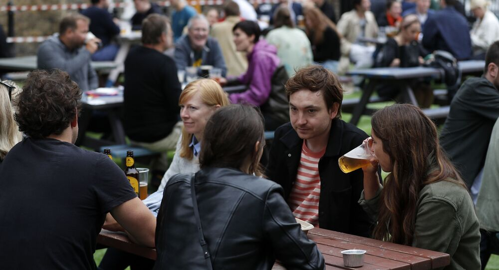 People enjoy their drinks at The Black Lion pub in central London on Saturday, 4 July, as the coronavirus lockdown was eased.