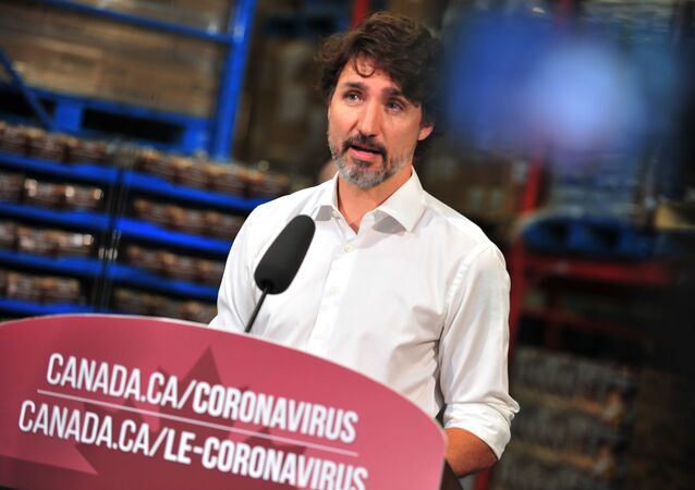 Canadian Prime Minister Justin Trudeau speaks to the press as he volunteers at the Moisson Outaouais food bank in Gatineau, Quebec, Canada, on July 3, 2020, during the coronavirus pandemic.
