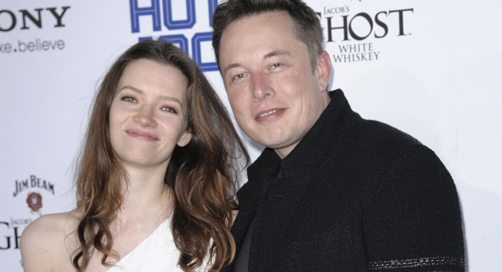 Businessman Elon Musk, right, and model Talulah Riley arrive at the 2013 Maxim Hot 100 celebration at Vanguard on Wednesday, May 15, 2013 in Los Angeles