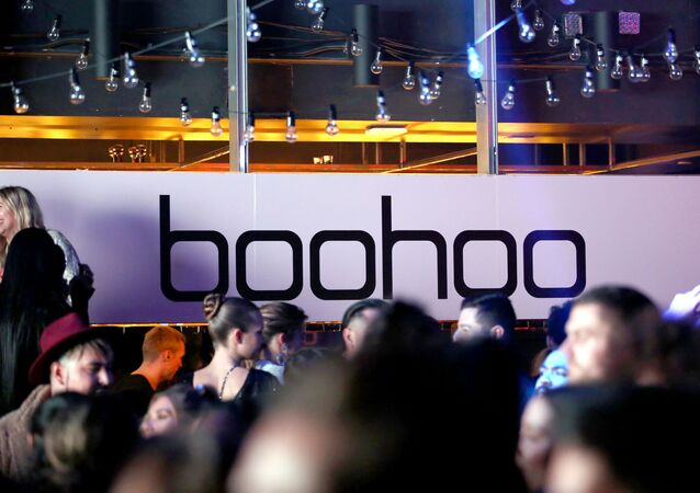 Signage is seen at boohoo x All That Glitters Launch Party on November 07, 2019 in Los Angeles, California