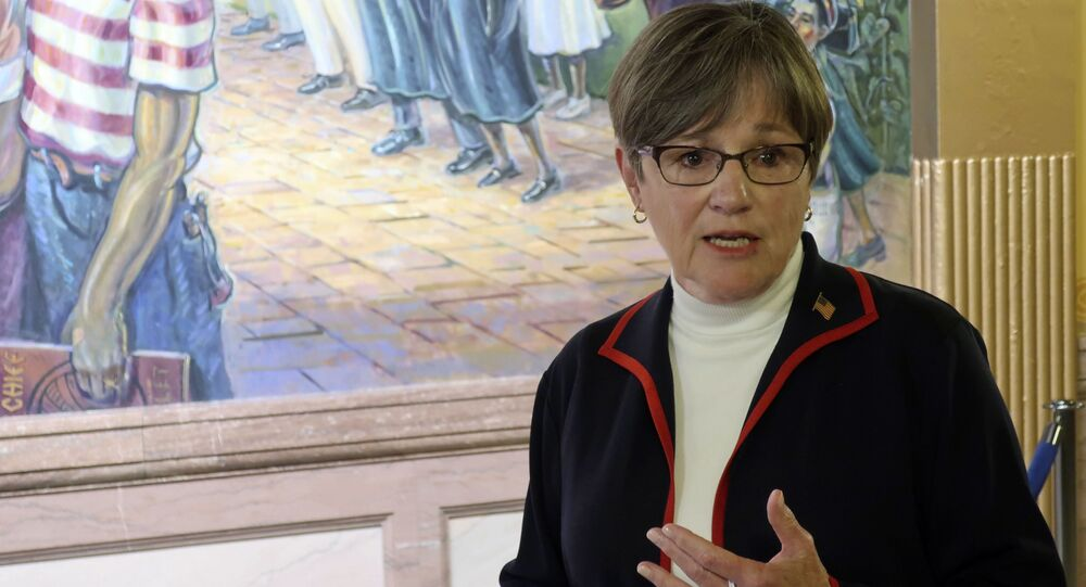 Kansas Gov. Laura Kelly answers questions from reporters about the coronavirus pandemic after a meeting with legislative leaders, Thursday, July 2, 2020, at the Statehouse in Topeka, Kan.