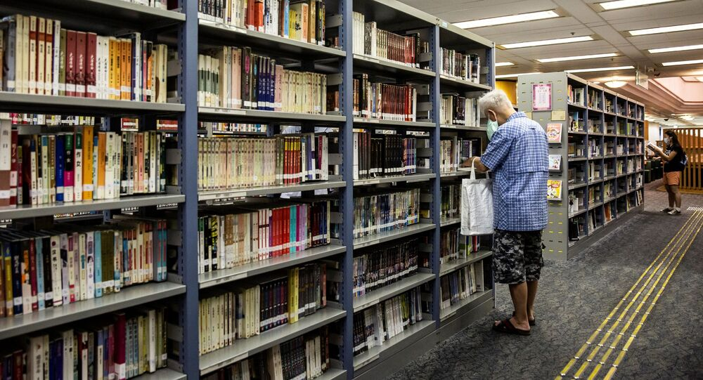 A man looks at books in a public library in Hong Kong on July 4, 2020.