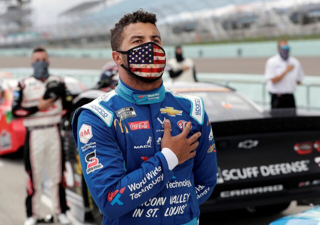 Bubba Wallace stands for the national anthem prior to the NASCAR Cup series race at Homestead-Miami Speedway