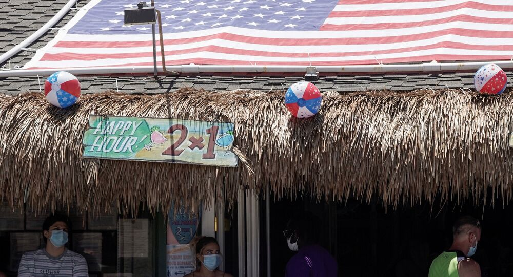 People queue for dine-in service outside the Baja Beach Bar in the Pacific Beach neighbourhood of San Diego, California, U.S., ahead of the Fourth of July holiday July 3, 2020.