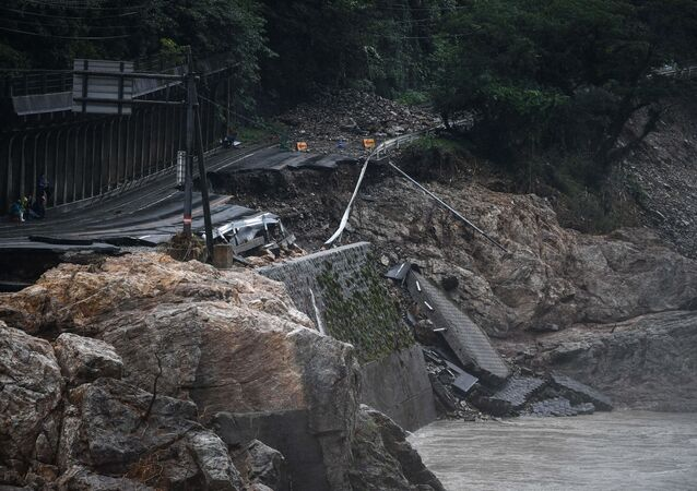 A collapsed road caused by heavy rain is seen in Kuma, Kumamoto prefecture on July 7, 2020. - Emergency services in western Japan were racing against time to rescue people stranded by devastating floods and landslides, with at least 50 feared dead and more torrential rain forecast.