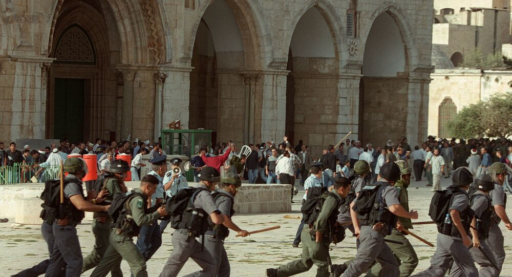 Israeli troops run as clashes erupt outside the Al-Aqsa mosque compound in Jerusalem's Old City 28 September 2000, following a visit to the holy site by Israeli right-wing opposition leader Ariel Sharon. The visit of Israel's current prime minister to Islam's third holiest shrine sparked the outbreak of the second intifada. Exhausted by a conflict both know they are incapable of winning, Israelis and the Palestinians are marking the fifth anniversary of this intifada 28 September 2005.