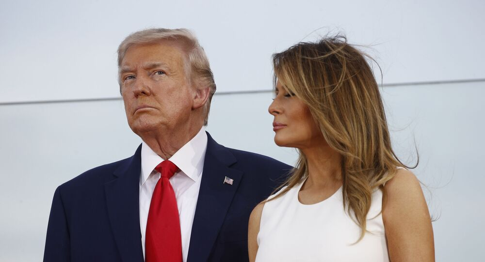 President Donald Trump and first lady Melania Trump stand onstage during a Salute to America event on the South Lawn of the White House, Saturday, July 4, 2020, in Washington