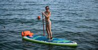 A girl enjoys standup paddleboarding in Sochi