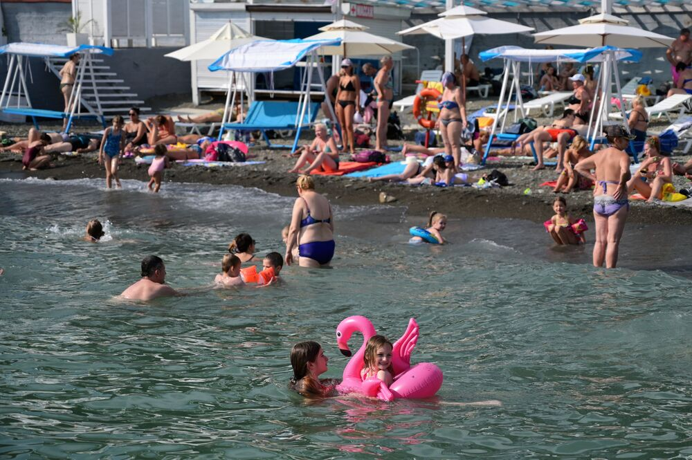 Adults and children enjoy summer on the 'Circus' beach in Sochi