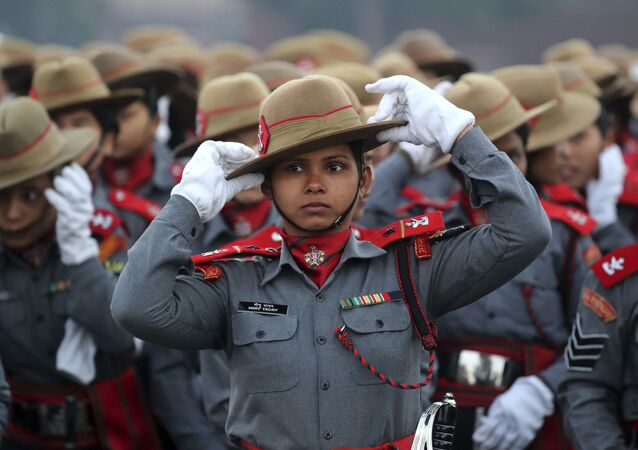 Indian Para-military women soldiers of Assam Rifles adjust their hats during the rehearsals for the upcoming Republic Day parade on Rajpath, the ceremonial boulevard, in New Delhi, India, Monday, Jan. 14, 2019