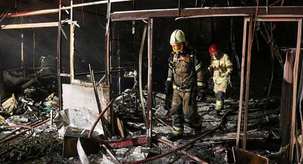 Firefighters inspect the site of an explosion at a medical clinic in the north of the Iranian capital Tehran, Iran, June 30, 2020