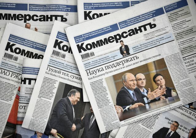 A picture taken on May 20, 2019, shows Kommersant daily newspaper issues.
