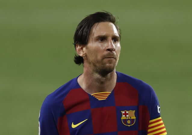 Barcelona's Lionel Messi during the Spanish La Liga soccer match between Sevilla and FC Barcelona at the Ramon Sanchez-Pizjuan stadium in Seville, Spain, Friday, June 19, 2020