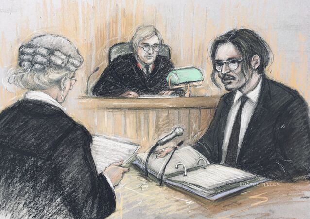 Johnny Depp being cross-examined by Sasha Wass QC, counsel for The Sun, at the High Court in London, on 7 July 2020.