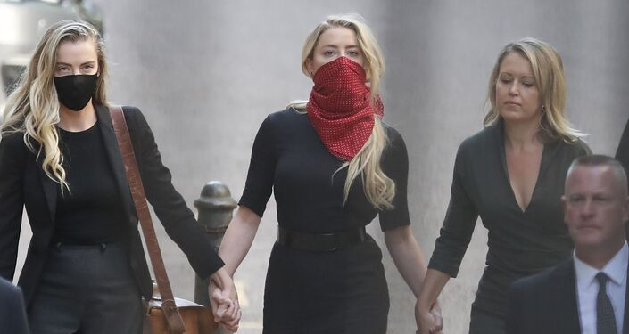 Actress Amber Heard, centre, arrives at the High Court in London for the defamation trial brought by her former husband Johnny Depp.