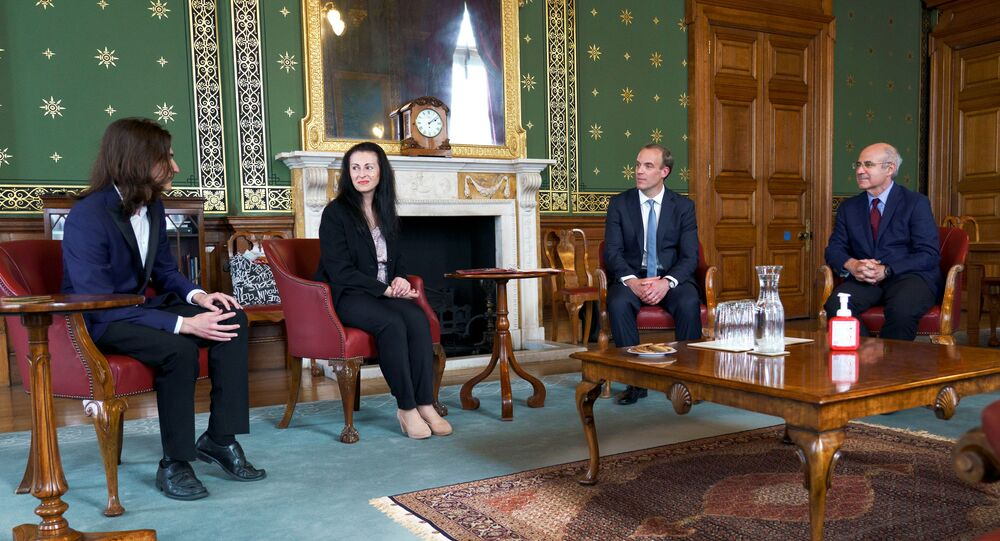 Britain's Foreign Secretary Dominic Raab meets with Magnitsky family - Natalia Magnitsky and Nikita Magnitsky, widow and son of Sergei Magnitsky, and Bill Browder in the Foreign and Commonwealth Office, following the Foreign Secretary's Statement on Global Human Rights Sanctions Regime given in the House of Commons, London, Britain, July 6, 2020