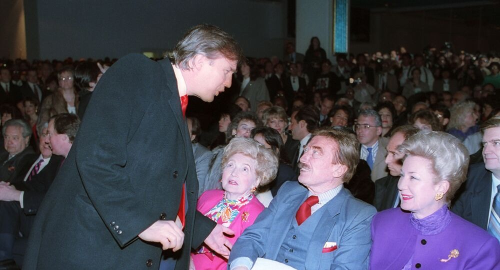 Donald Trump, left, talks with his parents, Mary and Fred and his sister, U.S. District Court Judge Maryanne Trump Barry, at the opening of Trump's Taj Mahal Casino Resort in Atlantic City, N.J., Thurs., April 5, 1990