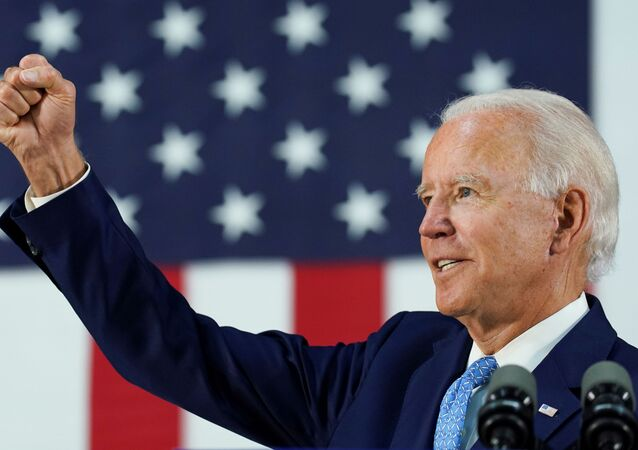 Democratic U.S. presidential candidate and former Vice President Joe Biden thrusts his fist while answering questions from reporters during a campaign event in Wilmington, Delaware, U.S., June 30, 2020.