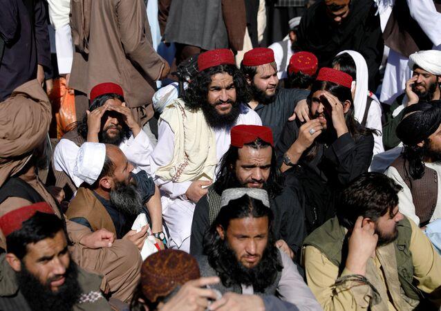 Newly freed Taliban prisoners sit at Pul-i-Charkhi prison, in Kabul