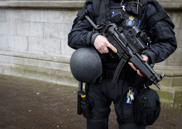 A Dutch military police officer stands guard at the Binnenhof during a patrol in The Hague on March 23, 2016 as security measures were reinforced in the wake of attacks in Brussels.
