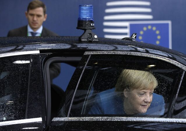 German Chancellor Angela Merkel steps out of her car as she arrives for a European Union Summit at European Union Headquarters in Brussels on October 18, 2019