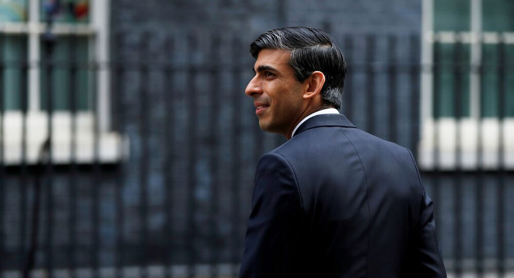 Chancellor of the Exchequer Rishi Sunak is seen as he arrives at Downing Street