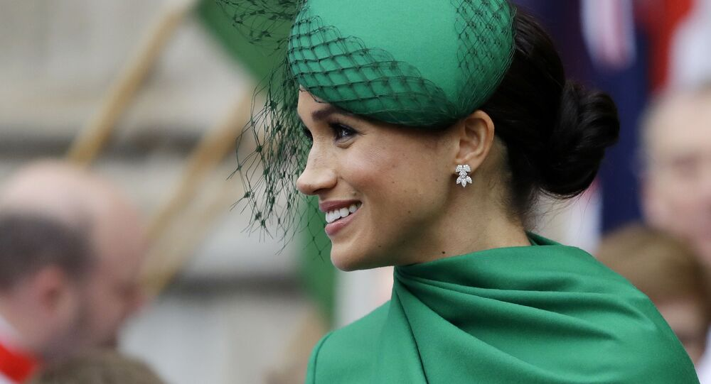 FILE - In this Monday, March 9, 2020 file photo, Britain's Meghan, the Duchess of Sussex leaves after attending the annual Commonwealth Day service at Westminster Abbey in London