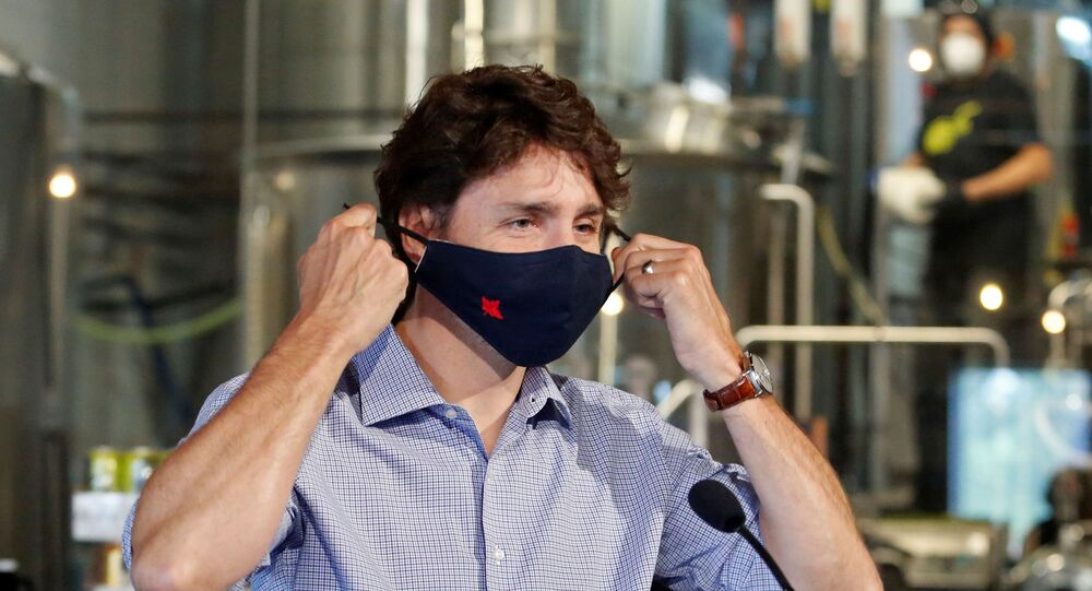 Canada's Prime Minister Justin Trudeau removes his face mask as he visits the Big Rig Brewery, which utilizes the Canada Emergency Wage Subsidy given to businesses affected by the coronavirus disease (COVID-19) outbreak, in Kanata, Ontario, Canada June 26, 2020.