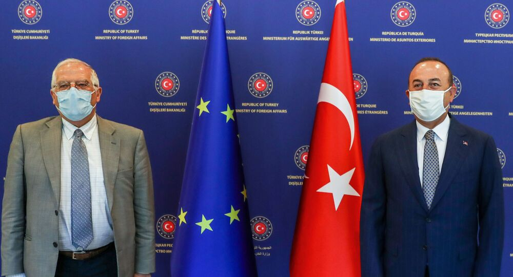 This handout picture provided by the Turkish Foreign Ministry Press office, shows Turkish Foreign Minister Mevlut Cavusoglu (R) and High Representative of the European Union for Foreign Affairs and Security Policy, Josep Borrell Fontelles (L) posing for a photo before their meeting in Ankara, on July 6, 2020.
