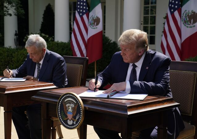 President Donald Trump and Mexican President Andres Manuel Lopez Obrador sign a joint declaration at the White House, Wednesday, July 8, 2020, in Washington.