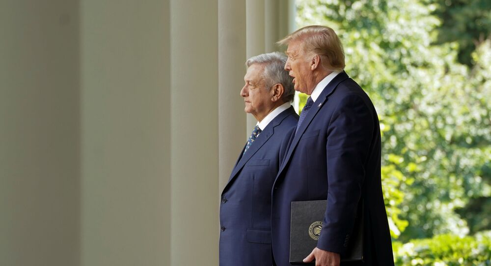 U.S. President Donald Trump leads Mexico's President Andres Manuel Lopez Obrador down the West Wing colonnade to a signing ceremony in the Rose Garden at the White House in Washington, U.S., July 8, 2020.