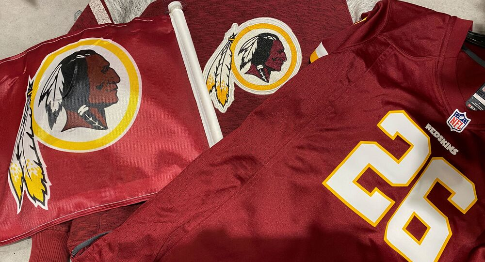 Washington Redskins football shirts and a team flag on sale at a sporting goods store in Bailey's Crossroads, Virginia, U.S., June 24, 2020.