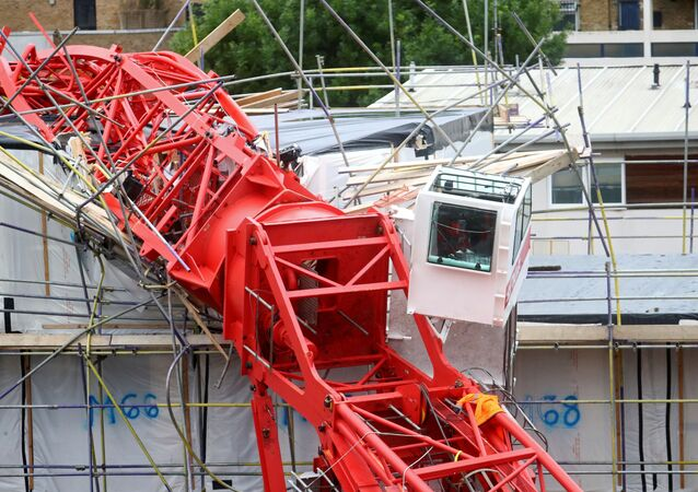 A collapsed crane at a construction site in Bow, east London