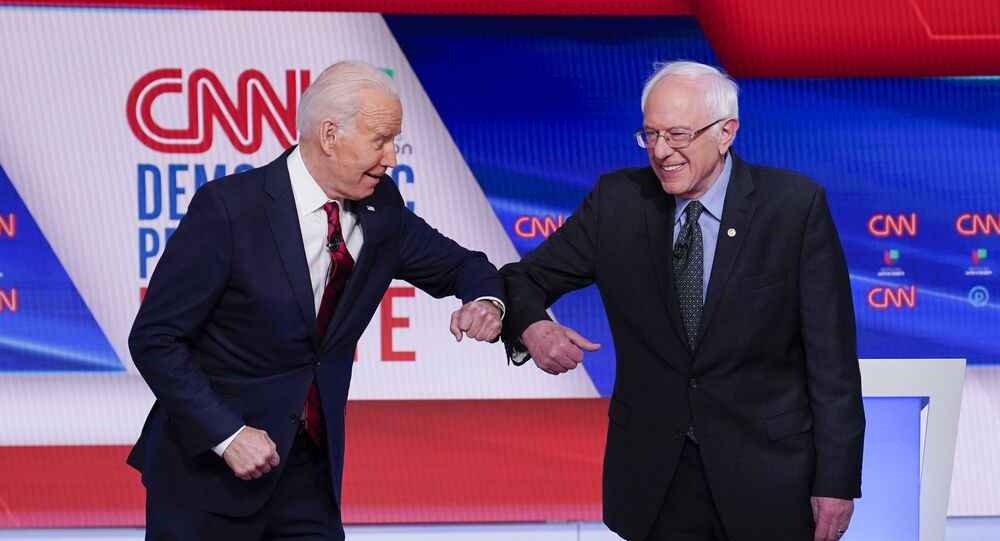 Former Vice President Joe Biden, left, and Sen. Bernie Sanders, I-Vt., right, greet one another before they participate in a Democratic presidential primary debate at CNN Studios in Washington, Sunday, March 15, 2020