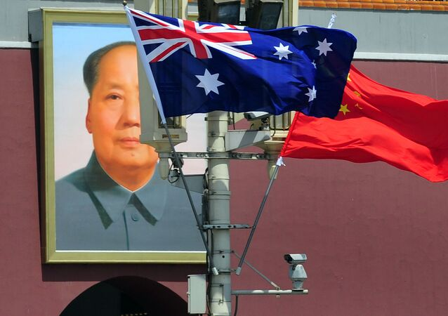 The national flags of Australia and China are displayed before a portrait of Mao Zedong facing Tiananmen Square, during a visit by Australia's Prime Minister Julia Gillard in Beijing on April 26, 2011