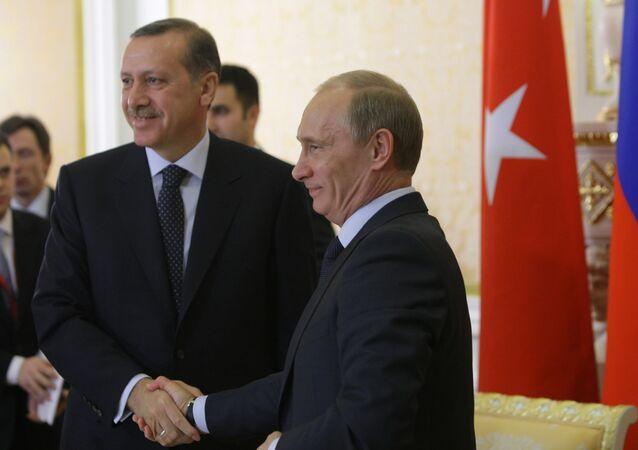 Russian Prime Minister Vladimir Putin and his Turkish counterpart Recep Tayyip Erdogan