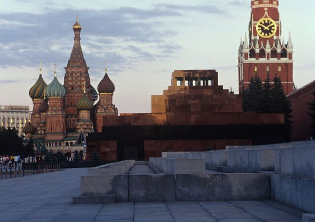 Spasskaya Tower of Moscow Kremlin, St. Basil's Cathedral and Vladimir Lenin Mausoleum on Red Square.