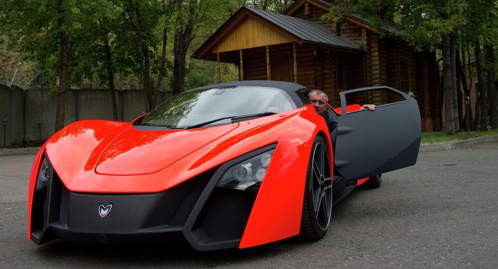 Nikolay Fomenko is seen inside a Marussia car prototype. File photo
