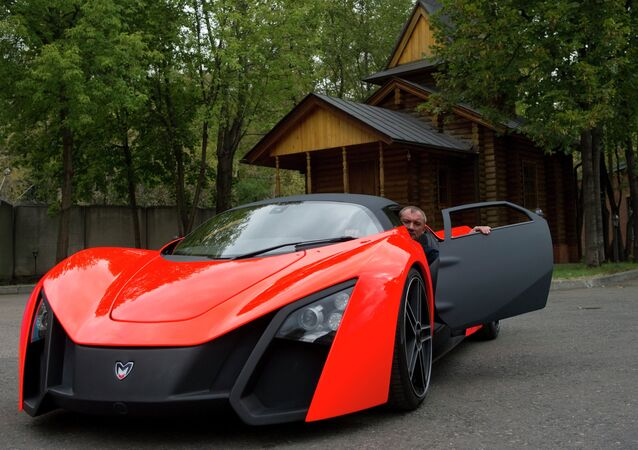 Nikolay Fomenko is seen inside a Marussia car prototype. File photo