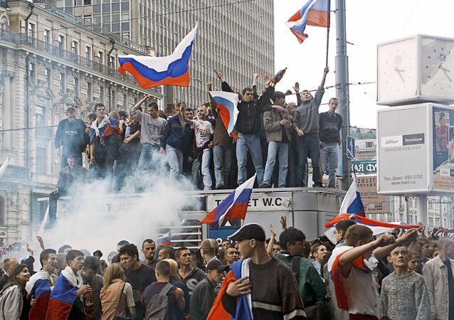 Football fans on Manezhnaya Square during the broadcasting of Russia vs. Japan match